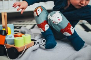 Think like a curious child. If toys or interesting items are in sight, there can be temptation to crawl or climb to retrieve them. -Image via Pexels