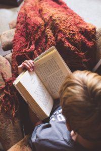 boy reading blanket