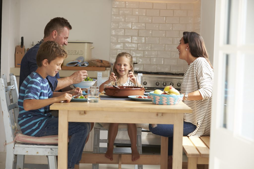Family At Home Eating Meal Together